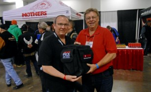 (l to r) Cliff Waller of Mothers presents Jim Madigan with a special award at the 2015 Motorama show.